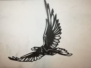 эмблема птицы из металла